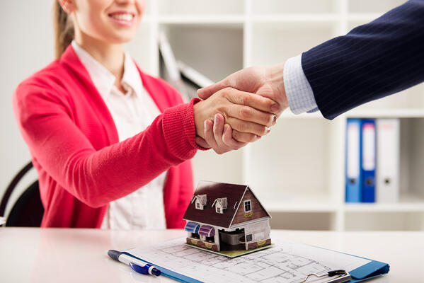 Property manager shaking hands with a client