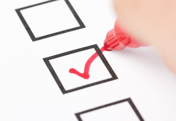 red check mark in black box of a checklist
