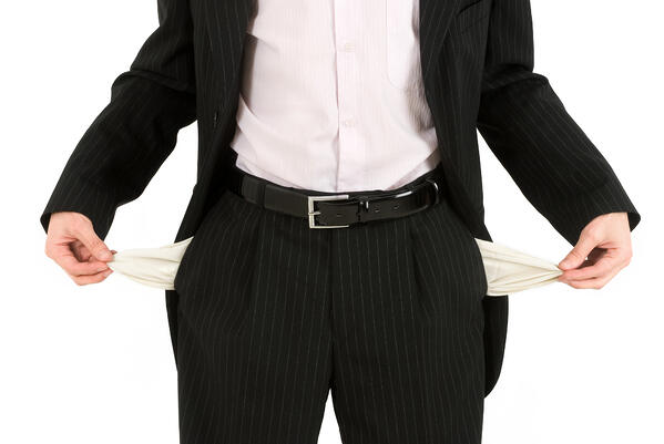 A man in a suit with pockets pulled out, indicating he has no money