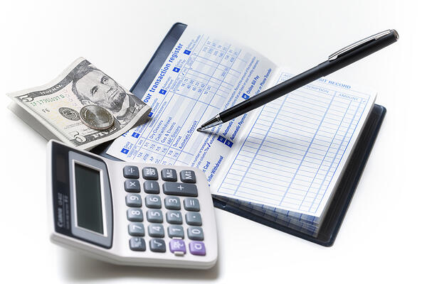 Bankbook with calculator and change