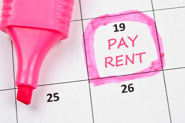"""A calendar with a pink marker circling a date and """"Pay Rent"""" is written on that date"""