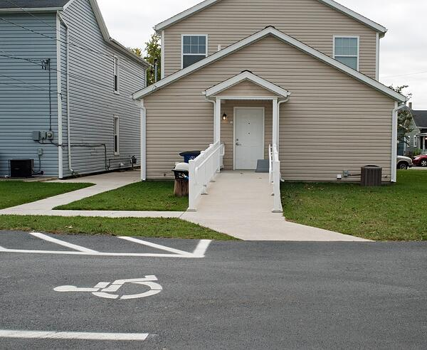 handicap accessible property with ramp and reserved parking