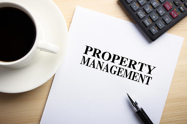 booklet on property management on coffee table