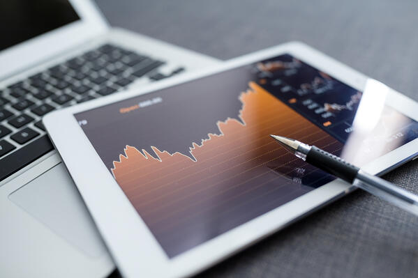 Digital tablet with business charts on a screen