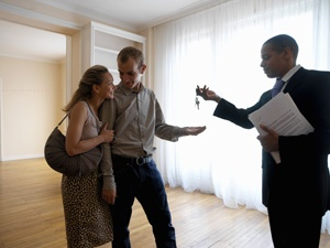 property manager in Michigan handing over keys to new tenants
