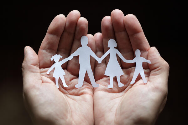 Paper chain family protected in cupped hands