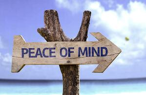 Peace of Mind wooden sign with a beach on background-1