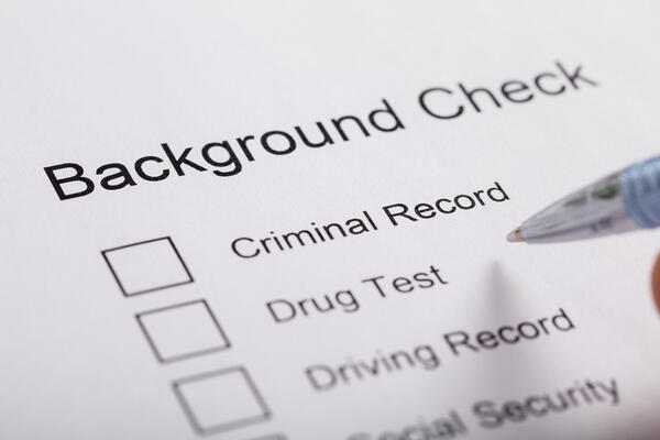 background check checklist and pen