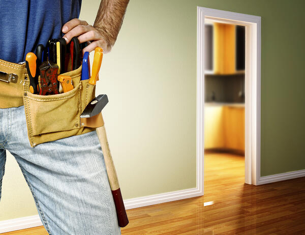 property management, handyman with tools on
